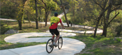 Cyclist on Medina River Greenway