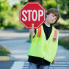 boy in street holding stop sign