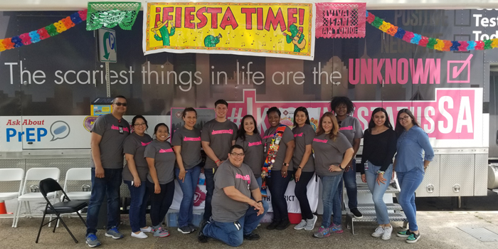 Health staff engaged with the public during Fiesta