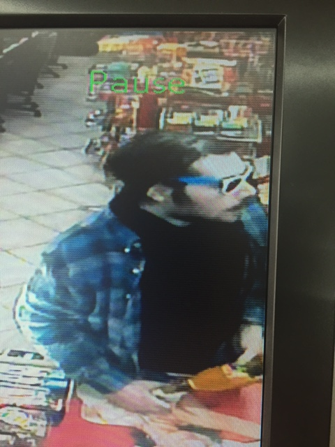 Robbery suspect looking right
