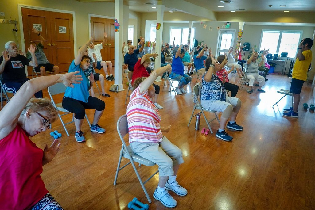 Seniors at a chair fitness class