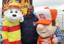 Chief Hood with Sparky and the Home Depot mascot